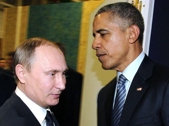 俄罗斯总统普京(左)与美国总统奥巴马。(新华/法新)