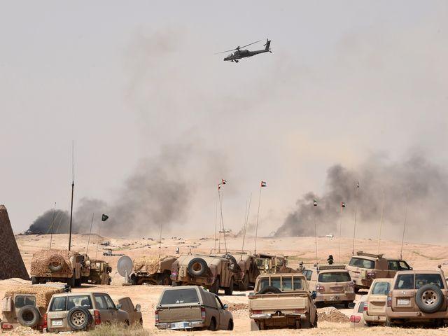 """2016年3月10日,代号""""北方雷霆""""的多国联合军演在沙特举行。(新华/法新)"""