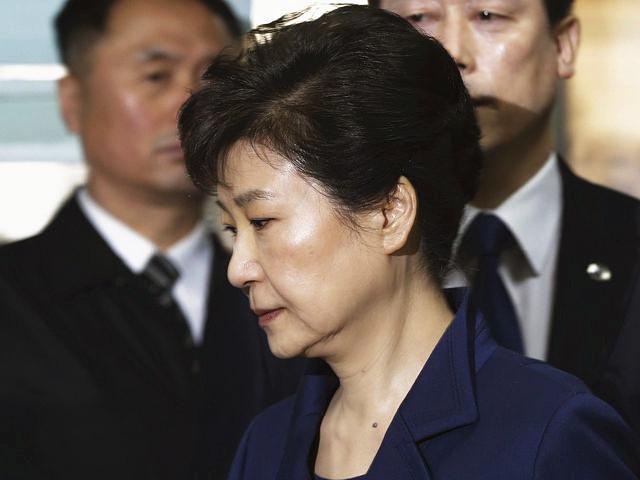 3月30日,韩国前总统朴槿惠步入法庭。(新华/美联)